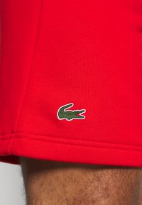 Lacoste Sport - SHORT TAPERED - Sports shorts - corrida/black - 5