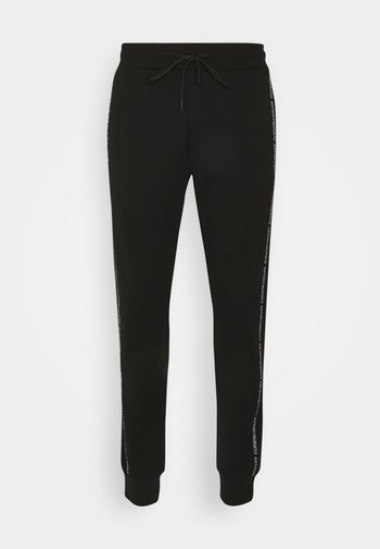 TROUSERS SLIM FIT IN TERRY FABRIC WITH RUBBER - Tracksuit bottoms - black
