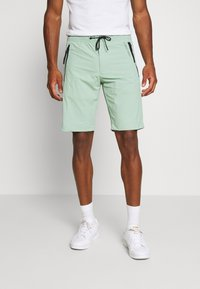 Calvin Klein - REGULAR FIT CRINKLE - Tracksuit bottoms - green - 0