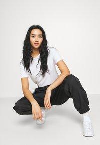 adidas Originals - BELLISTA NYLON CUFFED SPORT PANTS - Verryttelyhousut - black - 3