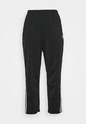 ZNE - Tracksuit bottoms - black