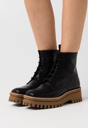 VERSALLES - Platform ankle boots - black