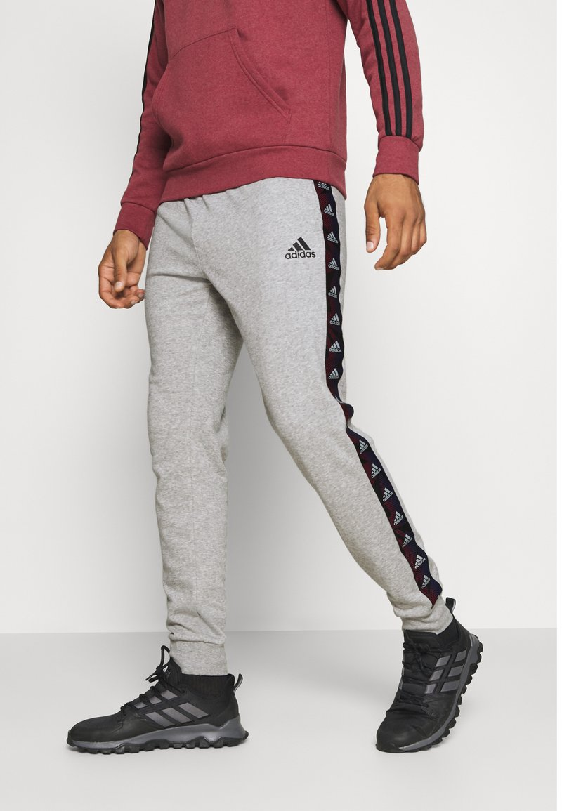 adidas Performance - ESSENTIALS TRAINING SPORTS PANTS - Teplákové kalhoty - grey/black