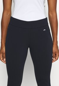 J.LINDEBERG - LEA PULL ON  - Trousers - navy - 5