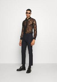 Twisted Tailor - KONA SHIRT - Camisa - black - 1