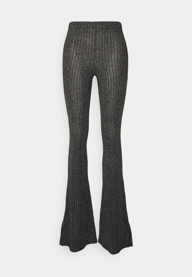 GLITTER FLARE - Trousers - black