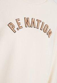 P.E Nation - DROP SHOT - Collegepaita - pearled ivory - 6