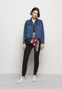 Love Moschino - Spodnie treningowe - black - 1