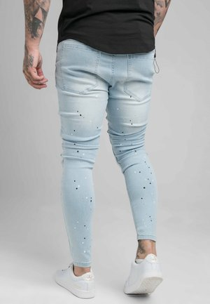 RIOT BIKER - Skinny džíny - light wash