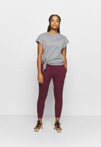 Nike Performance - FLOW HYPER 7/8 PANT - Tracksuit bottoms - night maroon - 1