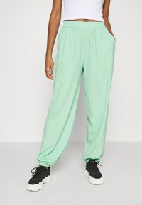 NA-KD - NA-KD X ZALANDO EXCLUSIVE - SPORTY FABRIC PANTS - Tracksuit bottoms - fresh mint - 0