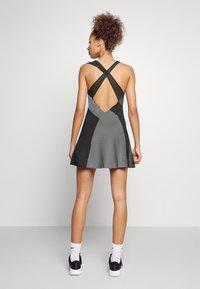 Nike Performance - DRESS - Sports dress - black/white - 2