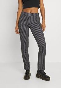 WAL G. - PIN STRIPE SKINNY TROUSERS - Trousers - black/white - 0