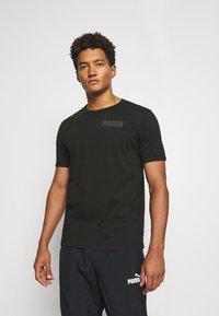 Puma - MODERN BASICS TEE - T-shirt med print - black - 0