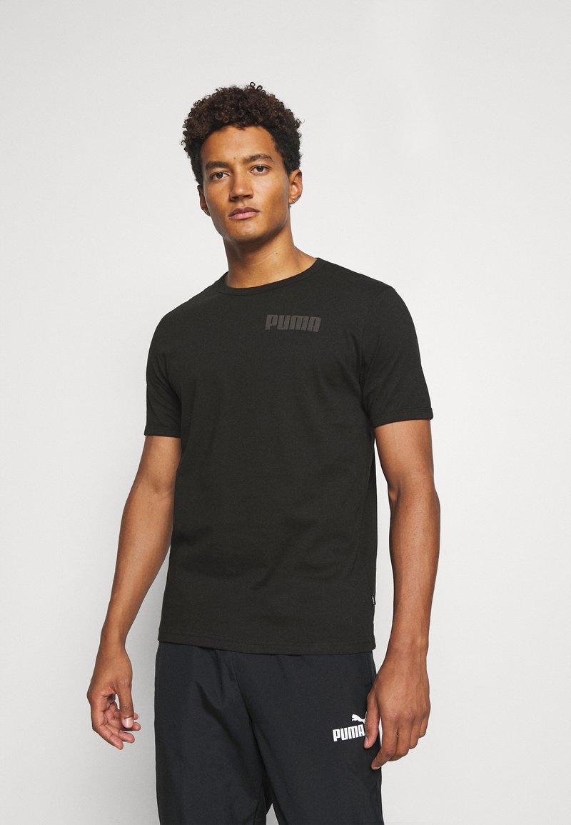 Puma - MODERN BASICS TEE - T-shirt med print - black