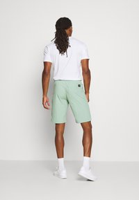 Calvin Klein - REGULAR FIT CRINKLE - Tracksuit bottoms - green