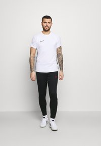 Nike Performance - ACADEMY 21 PANT - Tracksuit bottoms - black/siren red - 1