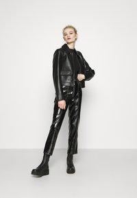 NA-KD - CONTRAST SEAM PANTS - Trousers - black - 1