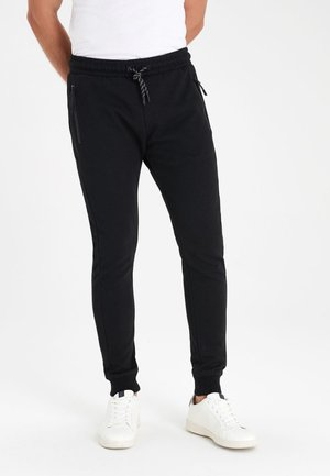 SLIM  - Tracksuit bottoms - black