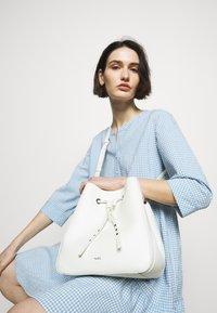 HUGO - VICTORIA DRAWSTRING - Across body bag - white - 0