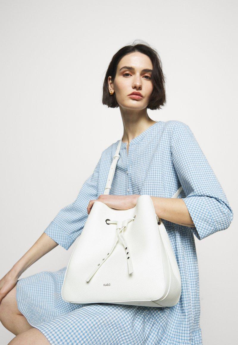 HUGO - VICTORIA DRAWSTRING - Across body bag - white