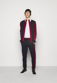 Bally - veste en sweat zippée - ink/red/bone - 1