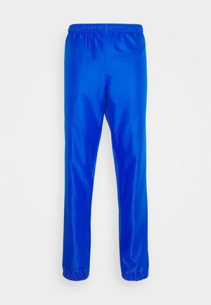 TENNIS PANT TAPERED - Tracksuit bottoms - lazuli/black/white
