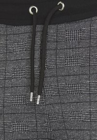 CLOSURE London - CHECKED JOGGER - Tracksuit bottoms - black - 2