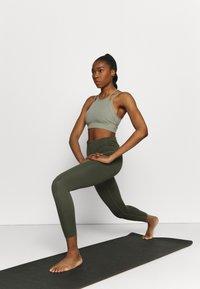 Nike Performance - INDY YOGA BRA - Light support sports bra - light army/light army/stone - 1