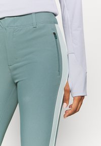 Under Armour - LINKS - Trousers - lichen blue - 3