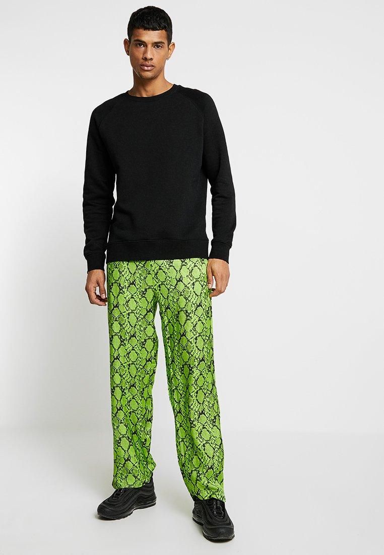 neon grønn bukse