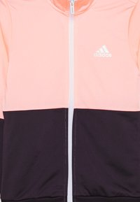 adidas Performance - ESSENTIALS PRIMEGREEN SPORTS TRACKSUIT - Survêtement - coral/purple/white