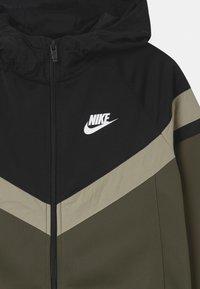Nike Sportswear - POLY SET UNISEX - Tracksuit - cargo khaki/black/stone/white - 3