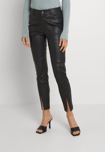 OBJERIKA STRETCH PANTS - Leather trousers - black