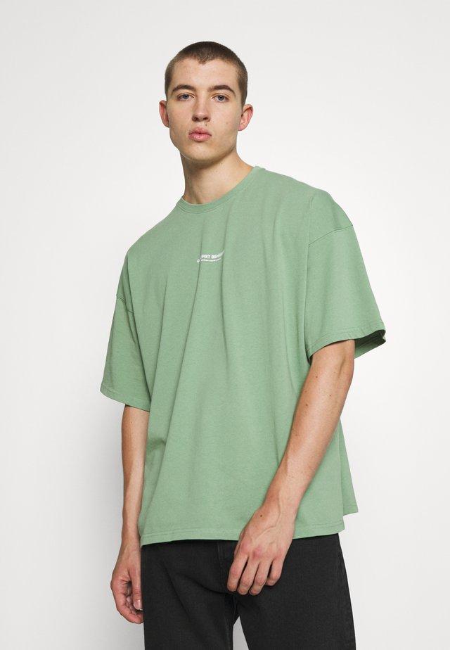 WASHED UNISEX - Basic T-shirt - green