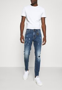 AMICCI - VERONA CARROT FIT  - Jeans Tapered Fit - dark blue - 0