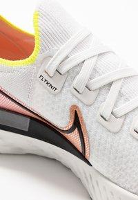 Nike Performance - REACT INFINITY RUN FK - Neutral running shoes - platinum tint/black/pink blast/total orange/lemon - 5