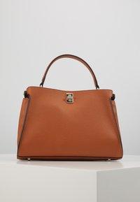 Guess - UPTOWN CHIC TURNLOCK SATCHEL - Handbag - cognac - 2
