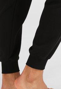 Calvin Klein Underwear - JOGGER - Pyjama bottoms - black - 4