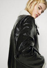 NA-KD - SHINY AVIATOR JACKET - Winter jacket - black/white - 5