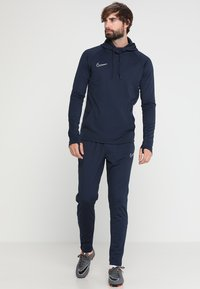 Nike Performance - DRY ACADEMY - Tracksuit bottoms - obsidian/white/white - 1