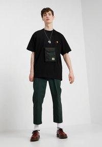Carhartt WIP - AMERICAN SCRIPT  - Basic T-shirt - black - 1