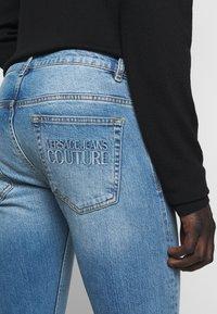 Versace Jeans Couture - DEBBIE  - Jean slim - indigo - 6