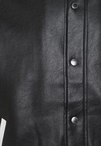 Karl Kani - JACKET UNISEX - Faux leather jacket - black - 2