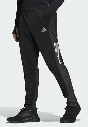 OWN THE RUN ASTRO  - Tracksuit bottoms - black
