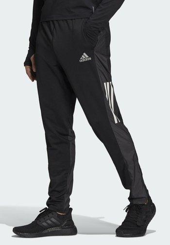 OWN THE RUN ASTRO  - Pantaloni sportivi - black