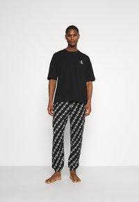 Calvin Klein Underwear - LOUNGE JOGGER - Pyjamas - black - 0