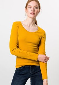 zero - MIT RUNDHALSAUSCHNITT - Long sleeved top - saffron - 0