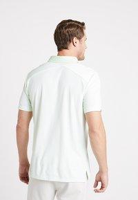 adidas Golf - CLIMACHILL TONAL STRIPE - Sports shirt - glow green/white - 2