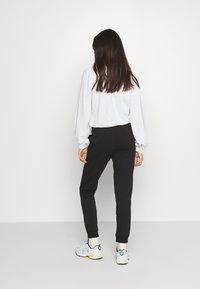 Champion Rochester - Pantalones deportivos - black - 2